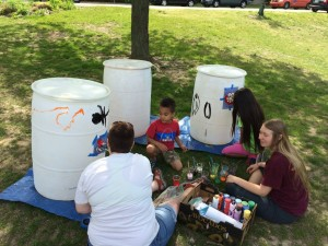 Volunteers decorate rain barrels, lending a unique, artistic flair to these functional stormwater containers.