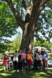 West Side community members gather to pose with Charlie, the first Mayor's Tree on the West Side