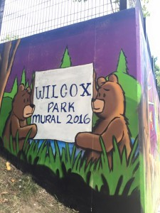 A new mural, created by dedicated community members, decorates walls at Wilcox Park. Public service helps give ownership to the community.